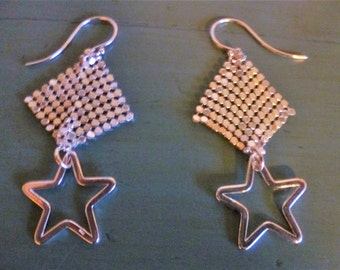 Star Power Earrings drape silver dotted diamonds above shining silver stars like shooting stars trailing light!