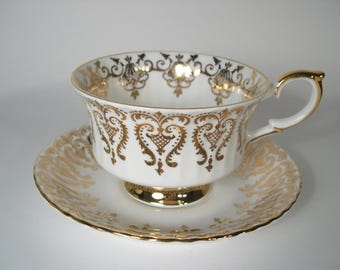Antique  Paragon  Tea cup And Saucer, White with gold, Gold scroll tea cup set.