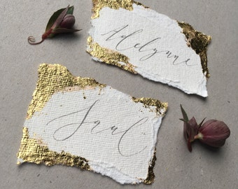Luxe gold leaf accented wedding place name with handwritten calligraphy