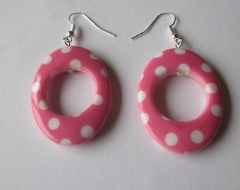 Big pink plastic spotty earrings