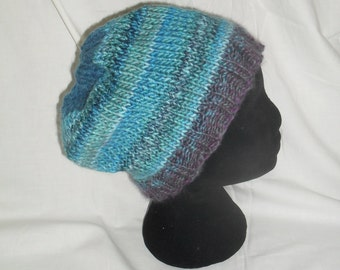 Knitted hat in gorgeous blues, aquas and purples.