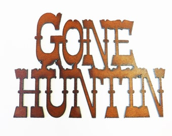 Gone Huntin sign made out of rusted rustic recycled rusty metal
