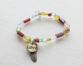 Bohemian Whimsical Glass Beaded Stretch Bracelet with Feather Charm