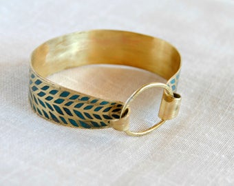 Recorded with turquoise patina brass bracelet