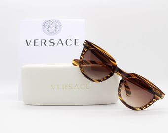 Versace clubmaster style sunglasses. Translucent 'wood' look with big V logo. BNWT and white hard case. Made in Italy.