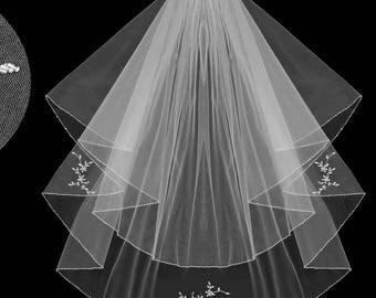 wedding veil white or ivory for beach wedding or else.it has a flower shells