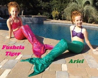 Mermaid tail.  7 Colors Swimmable Walkable or Party tails. Choose fabric tail or tail/top mermaid swim tail costume.