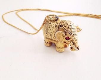 Vintage elephant locket. Vintage elephant necklace. Vintage elephant jewelry.