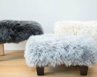Silver grey , pale grey , sheepskin footstool