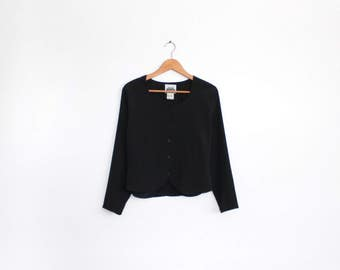Textured black blouse with subtle sweetheart neckline