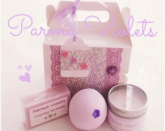 Parma Violets, scented bath bomb, soap and a gorgeous soy wax candle presented in a decorated gift box
