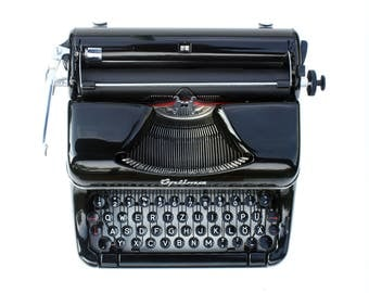 Portable black typewriter OPTIMA Elite