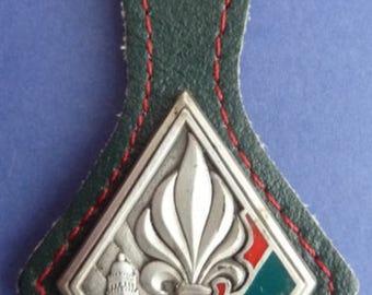 Original FrenchForeign Legion Badge 4thRegiment Of Infantry. On original leather mounting strap suspender.