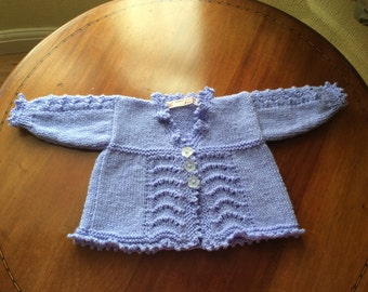 Gorgeous baby girl's long sleeved cardigan. Aqua green. Approximate age 3/6mths