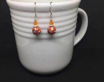 Orange, painted metal and Swarovski earrings