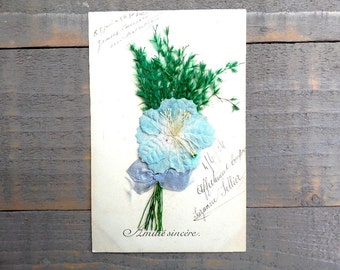 Antique french friendship postcard with embossed fabric .