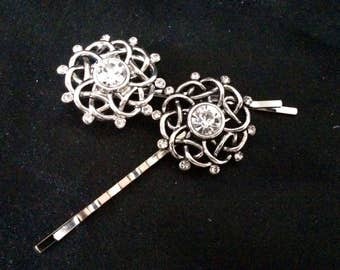Set Of 2 Silver Metal Hair Pins With Silver Metal Celtic Knot Like Orniments Covered In Crystals