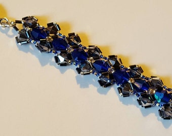 Handmade Cobalt AB and Crystal Heliotrope Bicones Wrapped in Gunmetal Bugle Beads with a Silver Heart Toggle Clasp