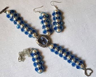 Set of watch, earrings, and necklace of cream Swarovski pearls with Capri blue bicones and light seed beads crossing blue Swarovski montees