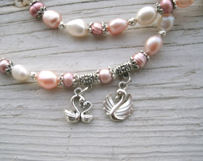 Swan Family Real Pearls Necklace, colors are pinks, white and silver, Freshwater Baroque & round Pearls with a family of swans charms -