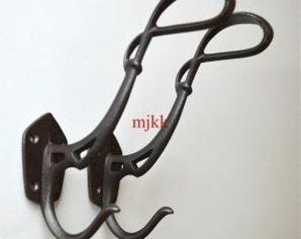 A pair of large Louis Majorelle cast iron coat hooks AL42