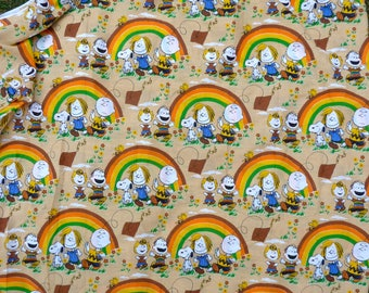 Peanuts fabric, featuring sad Charlie Brown flying a kite and others with a rainbow, Fall colors