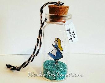 Alice in Wonderland Drink Me hanging glass bottle decoration.