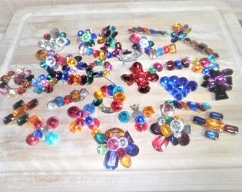 32 decorative colorfull plastic craft flowers and other shapes