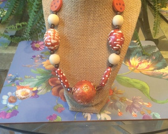 In the style of Iris Apfel, copper statement necklace, hand painted paper mâché and  porcelain beads,