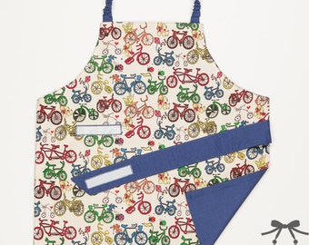 Child apron, Montessori apron, Water resistant apron, Fits 1.5 - 5 years, Bicycle + blue cotton lining