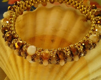 Weaving the bracelet handmade beads in bronze shade-cream