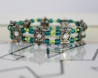 Silver tone swarovski crystal beads with blue and green glass beads, stretchy bracelet