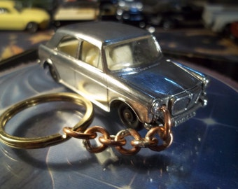 custom made old keychain 1962 to 1973 m.g.1100 sedan,raw-refinnished w/black wheels--hand made chain and jumprings/repaint mint