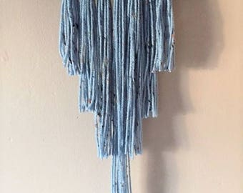 speckled blue yarn wall hanging