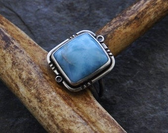 Sterling silver ring set with a Larimar cabochon