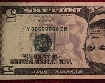 One five dollar flipper, fancy serial number US currency Collectible US dollars, repeating numbers, three sevens, and Ds as bookends
