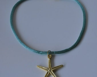 Golden sea star necklace and turquoise lace