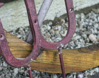 Pair of vintage handmade wrought iron coat hooks