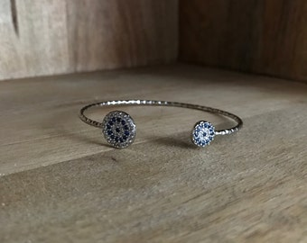 Silver bangle bracelet with CZ evil eye