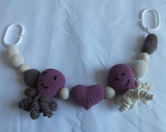 Octopus pram toy - pink brown and cream cotton yarn - embroidered eyes/mouths - wooden balls - plastic rings to attach to push chair