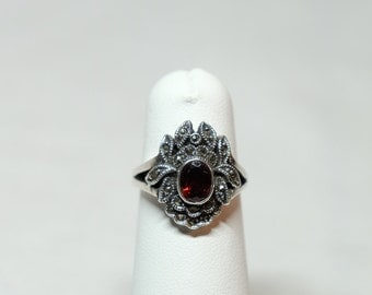 sterling silver marcasite ring with garnet-colored cabochon