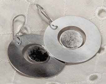Earrings, Women's Silver circular, oxidise eclipse, bespoke, dangle earrings, are Hallmarked by the Goldsmith Company London Assay office.