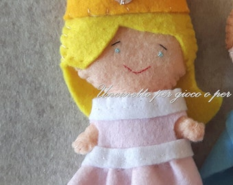 Felt doll. She can wear 1 princess dress with crown!