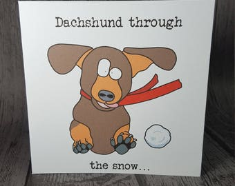 Dachshund dashing through the snow funny animal pun sausage dog Christmas card handmade by Relephant Cards. Matching badge available