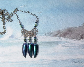 Necklace Bluish beetlewings+swarovski beads & cabochons and filigree bronze colour stamping
