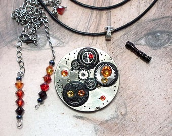 Steampunk brooch transformable in pendant+necklace, Gustav Klimt Style , pieces of watch, black resin, orange, yellow and red Swarovski cabs