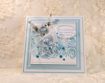 Exquisite, 3-D handmade wedding greeting card in tones of aqua and white. Handmade stickpins and paper roses.  Keepsake card with gift box.