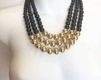 Black and gold beaded statement necklace