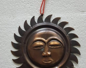 Sun with bells