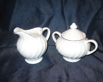 sugar and creamer with gold trim. free shipping u s a